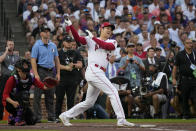 American League's Shohei Ohtani, of the Los Angeles Angeles, hits during the first round of the MLB All Star baseball Home Run Derby, Monday, July 12, 2021, in Denver. (AP Photo/David Zalubowski)