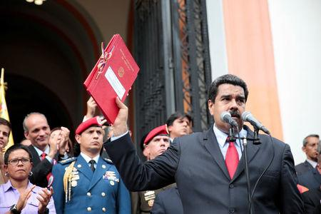 Venezuela's President Nicolas Maduro (R) attends a ceremony to sign off the 2017 national budget at the National Pantheon in Caracas, Venezuela October 14, 2016. Miraflores Palace/Handout via REUTERS ATTENTION EDITORS - THIS PICTURE WAS PROVIDED BY A THIRD PARTY. EDITORIAL USE ONLY.