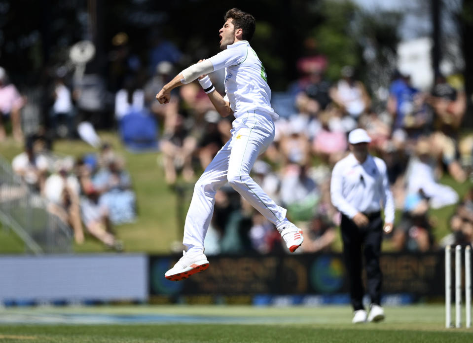 Pakistan bowler Shaheen Afridi celebrates the wicket of New Zealand's Tom Blundell during play on day one of the first cricket test between Pakistan and New Zealand at Bay Oval, Mount Maunganui, New Zealand, Saturday, Dec. 26, 2020. (Andrew Cornaga/Photosport via AP)