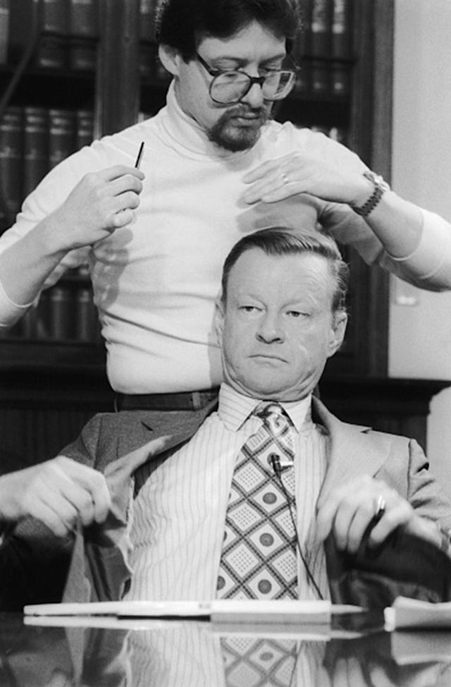 <p>National Security Advisor Zbigniew Brzezinski adjusts his coat prior to appearing on ABC's 'Issues and Answers' on April 27, 1980. Top administration officials reacted with disgust to reports that Iran may demand some form of payment for the return of the bodies of eight Americans killed in last week's aborted rescue efforts. (Photo: Bettmann/Getty IMages) </p>