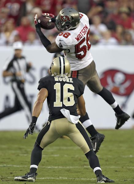 Tampa Bay Buccaneers linebacker Dekoda Watson (56) intercepts a pass by New Orleans Saints quarterback Drew Brees intended for Saints wide receiver Lance Moore (16) during the first quarter of an NFL football game on 2Sunday, Sept. 15, 2013, in Tampa, Fla. (AP Photo/Chris O'Meara)