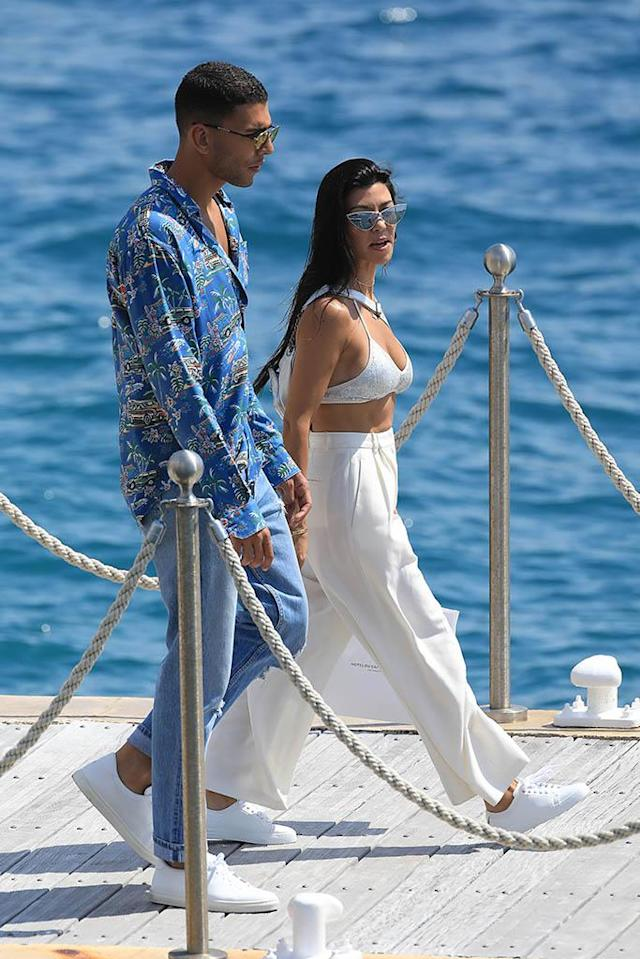 <p>Kourtney and Younes took a romantic stroll on the boardwalk. The reality star dressed all in white, capping off her look with a sparkly white bikini top. Basically, she never put a shirt on the entire time she was in France. (Photo: Robino Salvatore/GC Images) </p>