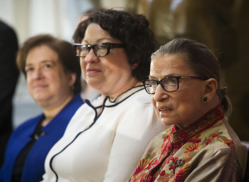 From left to right, U.S. Supreme Court, Associate Justices, Elena Kagan, Sonia Sotomayor, and Ruth Bader Ginsburg, on stage during a Women's History Month reception at Statuary Hall on Capitol Hill, hosted by Democratic Leader Rep. Nancy Pelosi, D-Calif., Wednesday, March 18, 2015, in Washington. Ruth Bader Ginsburg died at her home in Washington, on Sept. 18, 2020, the Supreme Court announced. (AP Photo/Pablo Martinez Monsivais)