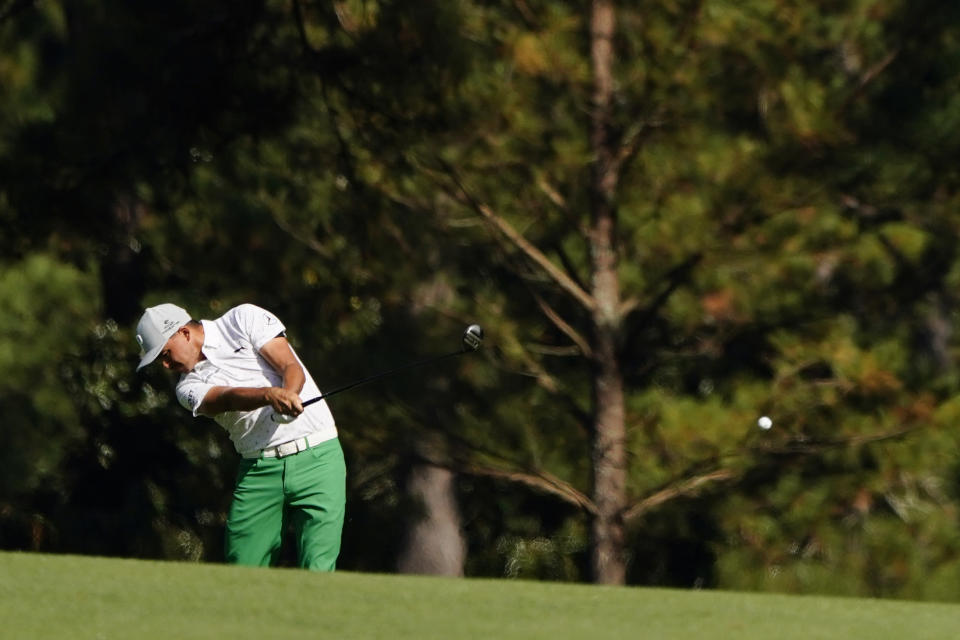 Rickie Fowler hits on the second fairway during the third round of the Masters golf tournament Saturday, Nov. 14, 2020, in Augusta, Ga. (AP Photo/Matt Slocum)