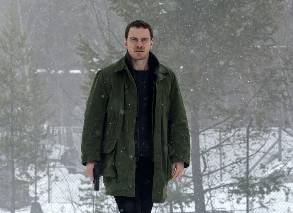 """This image released by Universal Pictures shows Michael Fassbender in the thriller """"The Snowman."""" (Jack English/Universal Pictures via AP)"""