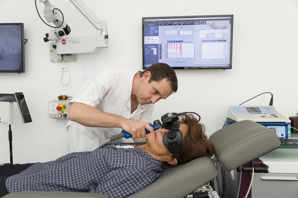 ENT doctor treating patients suffering from dizziness, Nice France, Caloric tests involving blowing air into the ear. Hot and cold air generates a response in inner ear through a modification in eye movement. (Photo by: BSIP/Universal Images Group via Getty Images)
