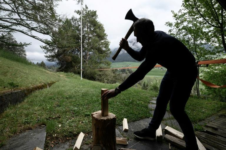 Wood-chopping is just one of the jobs that explorer Mike Horn has been tackling while in confinement