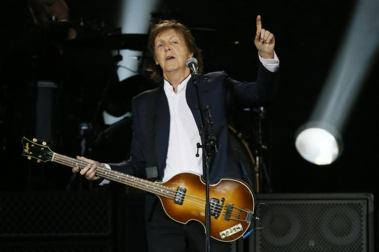 """Paul McCartney -- the only other surviving member of the band signed up by George Martin in 1962 -- penned a tribute, calling him """"a true gentleman"""" and """"a second father"""""""