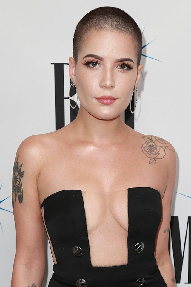 "<p>When the singer first got a buzzcut in December 2015, she made plenty of waves. She said at the time that ""<a rel=""nofollow"" href=""http://www.mtv.com/news/2880847/halsey-shaved-blue-hair/"">shaving my head was important to me</a> because I needed to be able to prove that I could still love myself if I did it."" She clearly still loves herself, because she was rocking the look at the 65th Annual BMI Pop Awards at the Beverly Wilshire Four Seasons Hotel on May 9. (Photo: Leon Bennett/WireImage) </p>"
