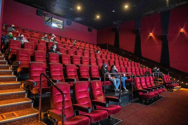PHOTO: Moviegoers sit, waiting for their movie to start at the AMC Burbank theatre on reopening day in Burbank, California, March 15, 2021. (Valerie Macon/AFP via Getty Images, FILE)