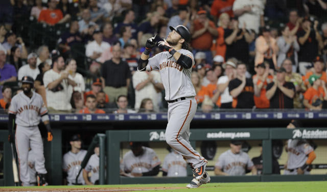 """<a class=""""link rapid-noclick-resp"""" href=""""/mlb/players/8945/"""" data-ylk=""""slk:Brandon Crawford"""">Brandon Crawford</a> hit a home run off his brother-in-law <a class=""""link rapid-noclick-resp"""" href=""""/mlb/players/9121/"""" data-ylk=""""slk:Gerrit Cole"""">Gerrit Cole</a> Tuesday while his sister watched awkwardly from the stands. (AP)"""
