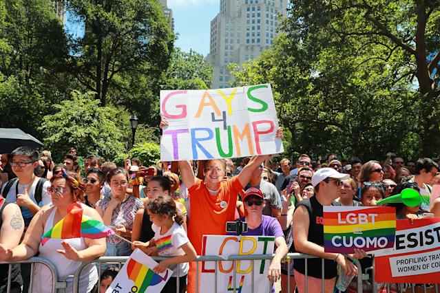 "<p>A Hillary Clinton impersonator holds up ""Gays for Trump"" sign during the N.Y.C. Pride Parade in New York on June 25, 2017. (Photo: Gordon Donovan/Yahoo News) </p>"