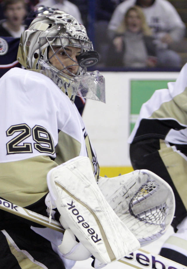 Pittsburgh Penguins' Marc-Andre Fleury makes a save against the Columbus Blue Jackets during the second period of Game 6 of a first-round NHL playoff hockey series Monday, April 28, 2014, in Columbus, Ohio. (AP Photo/Jay LaPrete)