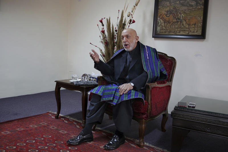 Former Afghan President Hamid Karzai gestures while speaking during an interview with The Associated Press, in Kabul, Afghanistan, Tuesday, Dec. 10, 2019. Karzai, whose final years in power were characterized by a cantankerous relationship with the United States, said on Tuesday that Washington used blackmail and corruption to manipulate his officials, undermine his government and foment violence among the country's many factions. (AP Photo/Altaf Qadri)