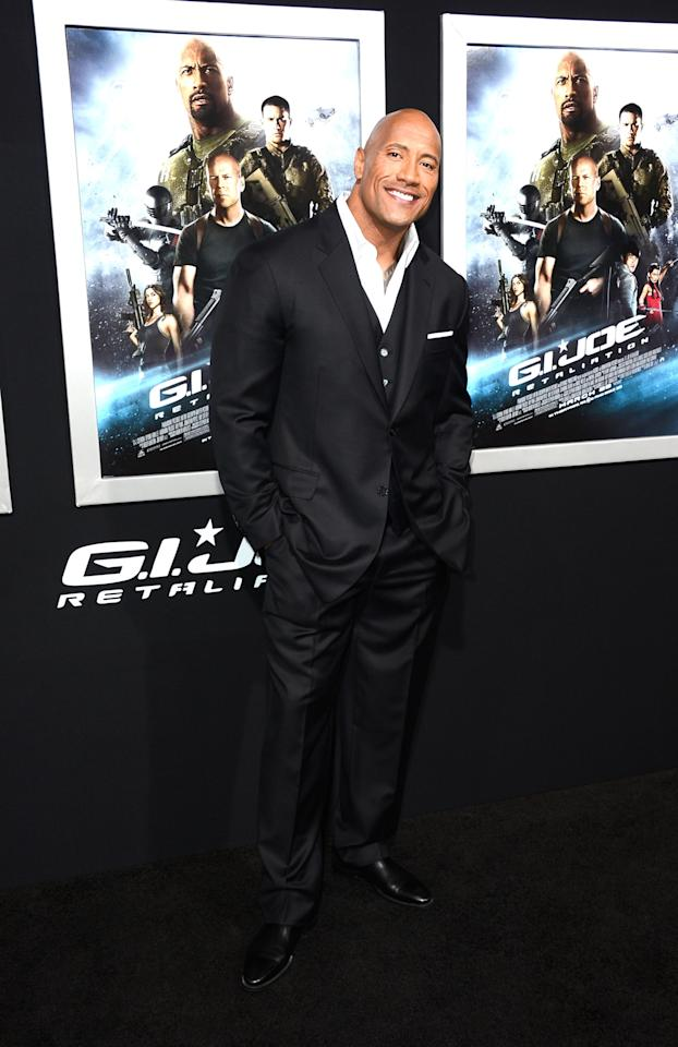 "HOLLYWOOD, CA - MARCH 28:  Actor Dwayne Johnson arrives at the Premiere of Paramount Pictures' ""G.I. Joe: Retaliation"" at TCL Chinese Theatre on March 28, 2013 in Hollywood, California.  (Photo by Frazer Harrison/Getty Images)"