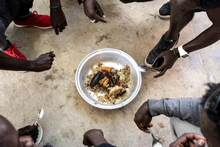Onions are a key ingredient in Senegal's national fish and rice dish, Thieboudienne (AFP/JOHN WESSELS)