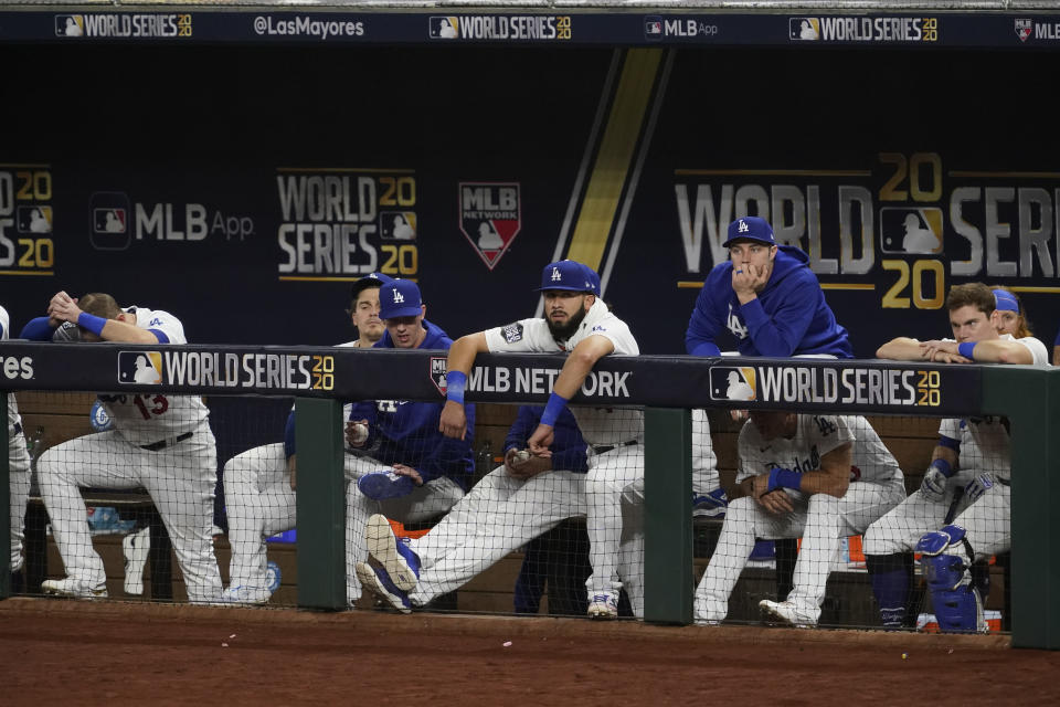 Members of the Los Angeles Dodgers watch during the seventh inning in Game 2 of the baseball World Series against the Tampa Bay Rays Wednesday, Oct. 21, 2020, in Arlington, Texas. (AP Photo/Tony Gutierrez)