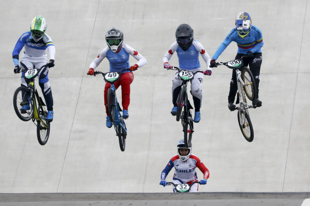 From left to right, Priscilla Stevaux of Brazil, Daina Tuchscherer of Canada, Drew Mechielsen of Canada and Mariana Pajon of Colombia compete competes in women's cycling bmx heat at the Pan American Games in Lima, Peru, Friday, Aug. 9, 2019. (AP Photo/Fernando Llano)
