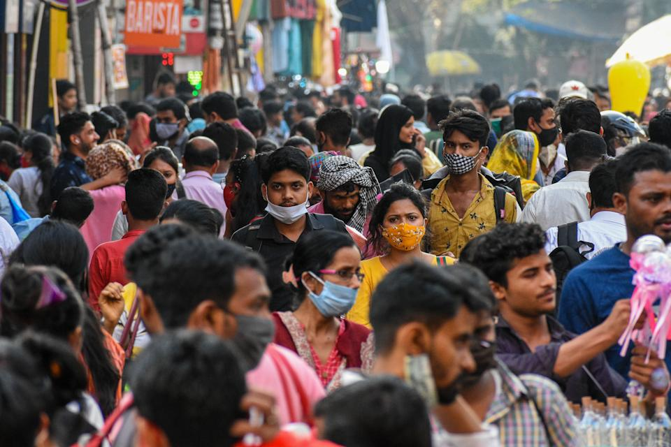 Citizens seen with face masks, some wearing them improperly, at a shopping market in Kolkata, India.