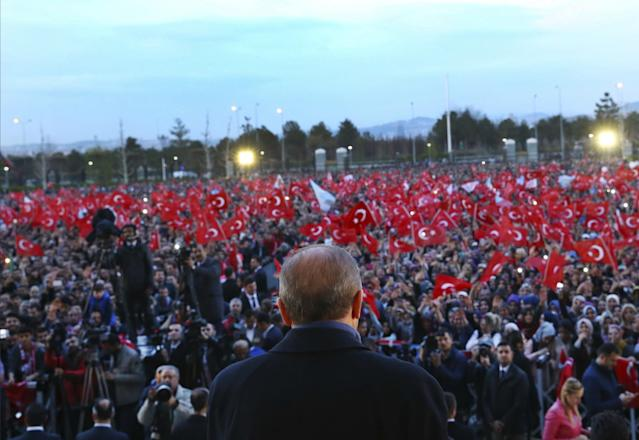 <p>Turkey's President Recep Tayyip Erdogan delivers a speech during a rally a day after the referendum, outside the Presidential Palace, in Ankara, Turkey, Monday, April 17, 2017. Turkey's main opposition party urged the country's electoral board Monday to cancel the results of a landmark referendum that granted sweeping new powers to Erdogan, citing what it called substantial voting irregularities. (Press Presidency Press Service via AP, Pool) </p>