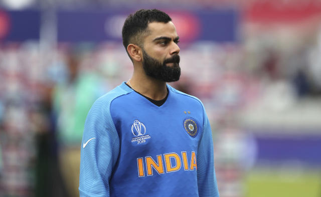 India's captain Virat Kohli reacts after their loss in the Cricket World Cup semi-final match against New Zealand at Old Trafford in Manchester, England, Wednesday, July 10, 2019. (AP Photo/Aijaz Rahi)