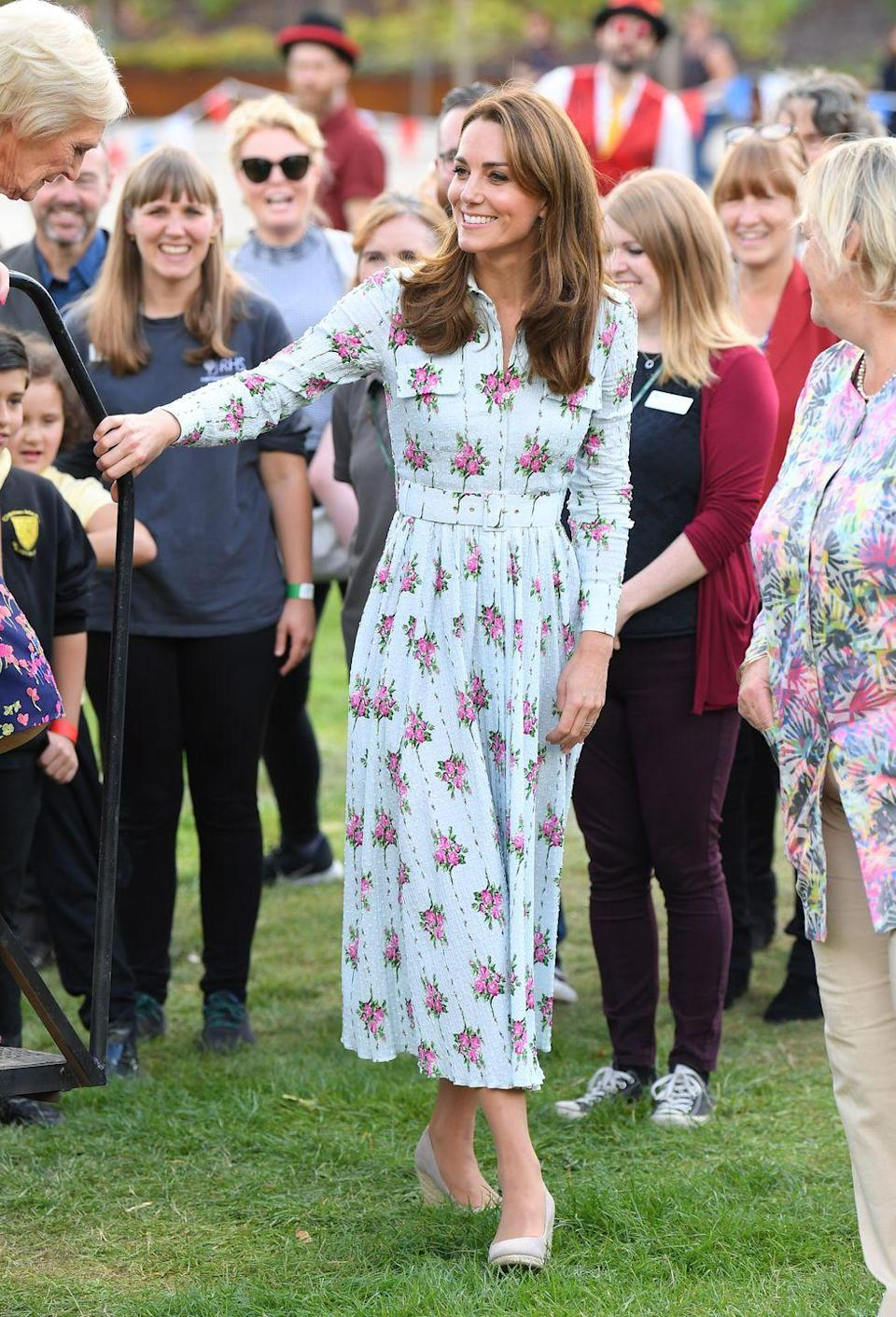 """<p>The Duchess stunned in <a href=""""https://www.townandcountrymag.com/style/fashion-trends/a28965273/kate-middleton-floral-emilia-wickstead-back-natural-play-garden-photos/"""" rel=""""nofollow noopener"""" target=""""_blank"""" data-ylk=""""slk:a floral Emilia Wickstead dress"""" class=""""link rapid-noclick-resp"""">a floral Emilia Wickstead dress</a> for a surprise appearance at the """"Back to Nature"""" festival in Wisley. She paired the breezy dress with nude wedges.</p>"""