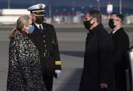 Estrid Brekkan, Icelandic Chief of Protocol, left, and Captain Jon Gudnason, base commander, greet US Secretary of State Antony Blinken, second right, as he disembarks his airplane upon arrival at Keflavik Air Base in Iceland, May 17, 2021, his second stop on a 5-day European tour. (Saul Loeb/Pool Photo via AP)