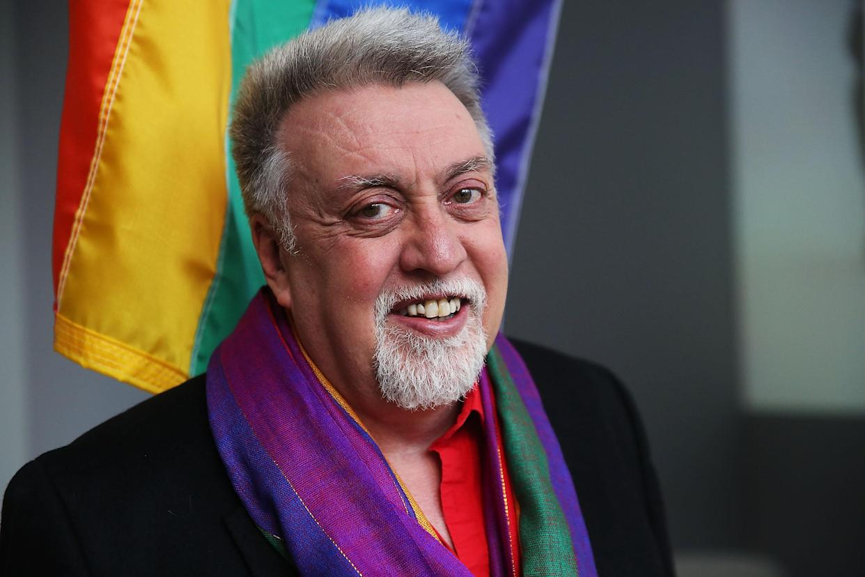 NEW YORK, NY - JANUARY 07:  Rainbow Flag Creator Gilbert Baker poses at the Museum of Modern Art (MoMA) on January 7, 2016 in New York City. MoMa announced in June 2015 its acquisition of the iconic Rainbow Flag into the design collection. Baker, an openly gay artist and civil rights activist, designed the Rainbow Flag in 1978. The flag has since become a prominent symbol to the gay community around the world. (Photo by Spencer Platt/Getty Images)