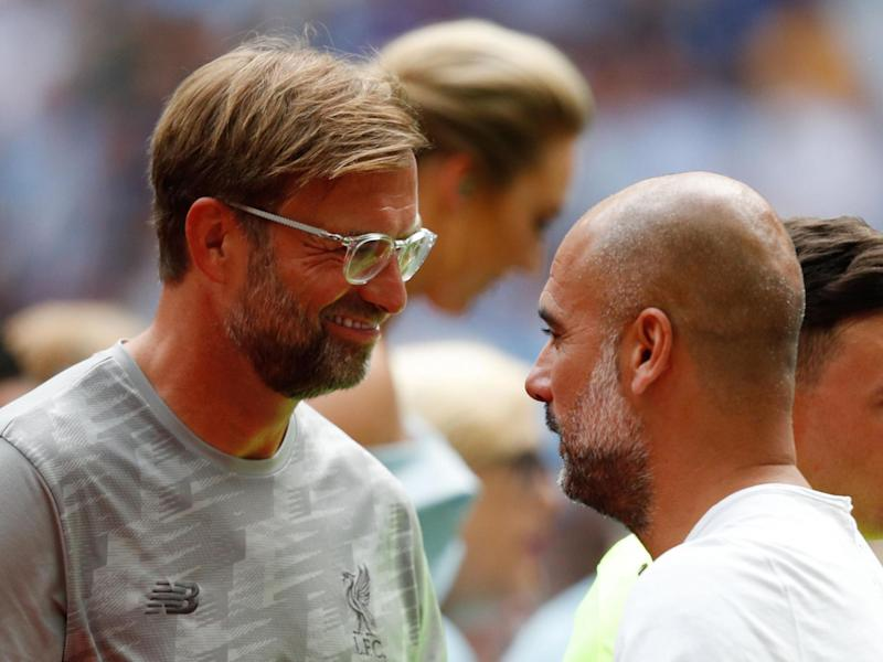 Liverpool manager Jurgen Klopp with Manchester City manager Pep Guardiola: AFP via Getty Images