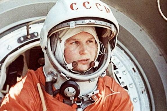 Soviet cosmonaut Valentina Tereshkova, the first woman to fly in space, climbs into her capsule, Vostok 6, in 1963.