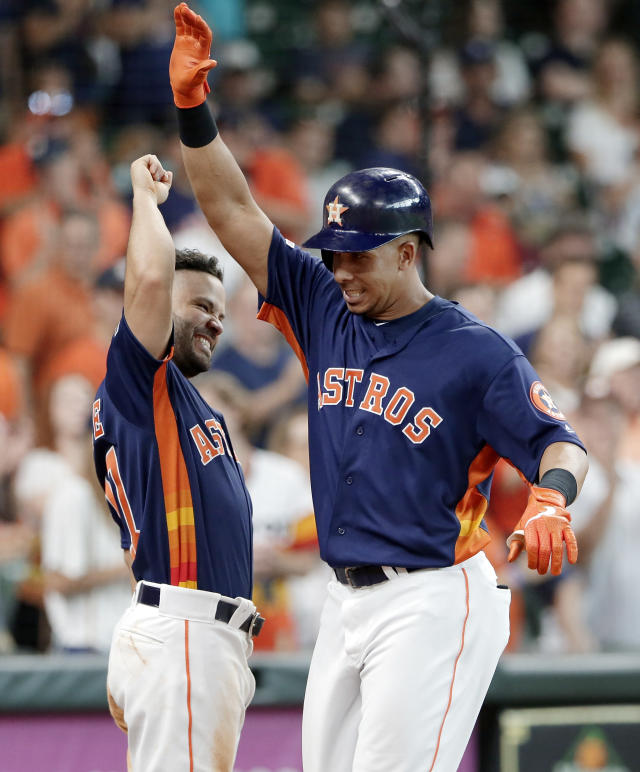 Houston Astros Jose Altuve, left, and Michael Brantley, right, celebrate Brantley's home run during the eighth inning of a baseball game against the Texas Rangers, Sunday, July 21, 2019, in Houston. (AP Photo/Michael Wyke)