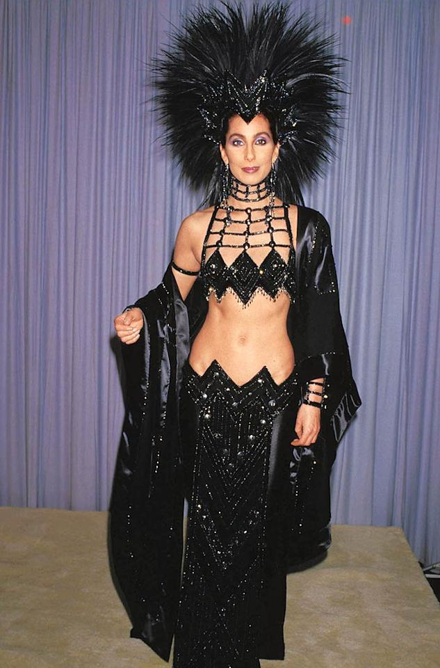 """<b>1986:</b> Responding to an Academy snub for her role in """"Mask"""" -- """"They said I didn't dress like a serious actress and my boyfriends were too young"""" -- Cher dreamed up this Mohawk-inspired showstopper. """"I was about 10 feet tall with the headdress.""""   <a href=""""http://www.instyle.com/instyle/package/transformations/photos/0,,20290120_1179632_1044596,00.html?xid=omg-cher-aguilera-trans?yahoo=yes"""" target=""""new"""">See Christina Aguilera's Transformation</a> Ralph Dominguez/Globe Photos - 1986"""