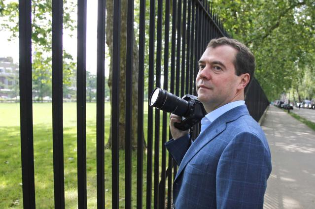 Russian Prime Minister Dmitry Medvedev holds his camera as he walks in London, on Saturday, July 28, 2012. Medvedev came to London attend the Opening Ceremony for the 2012 Olympic Summer Games. (AP Photo/RIA-Novosti, Dmitry Astakhov, Government Press Service)