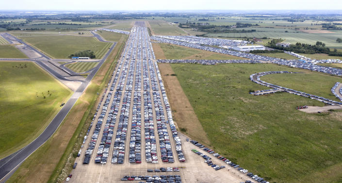 Thousands of unwanted new and used cars line up on June 09, 2020, at Thurleigh Airfield in Bedfordshire. Britain's economy slumped by 20.4% in April in the biggest monthly decline since records began as the coronavirus lockdown paralysed the country. Photo: Chris Gorman/Getty Images