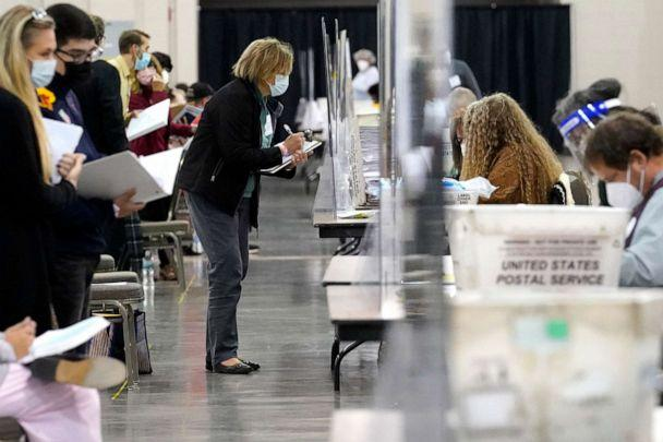 PHOTO: Recount observers watch ballots during a Milwaukee hand recount of Presidential votes at the Wisconsin Center, Nov. 20, 2020, in Milwaukee, Wis. (Nam Y. Huh/AP, FILE)