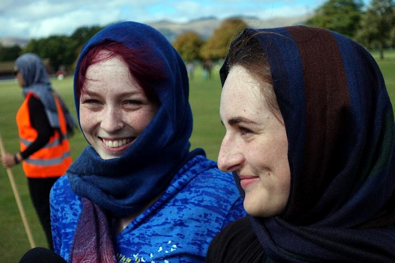 Christchurch sisters Madison and Sophie Hider attend a gathering for victims of the twin mosques massacre (AFP Photo/Jerome TAYLOR)