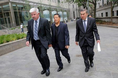 Macau real estate developer Ng Lap Seng (C), accused of bribing former United Nations General Assembly president John Ashe, exits U.S Federal Court in the Manhattan borough of New York, U.S., June 27, 2016.  REUTERS/Andrew Kelly