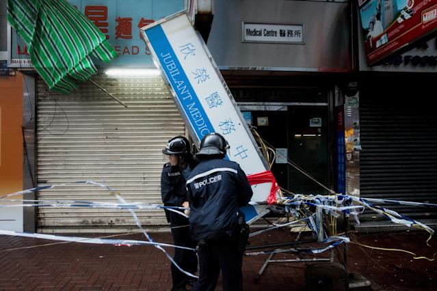 <p>Police deal with a damaged light board as typhoon Hato hits Hong Kong on Aug. 23, 2017 in Hong Kong. (Photo: Billy H.C. Kwok/Getty Images) </p>