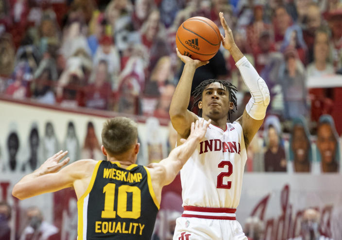 Indiana guard Armaan Franklin (2) shoots the winning basket during the second half of an NCAA college basketball game against Iowa, Sunday, Feb. 7, 2021, in Bloomington, Ind. (AP Photo/Doug McSchooler)