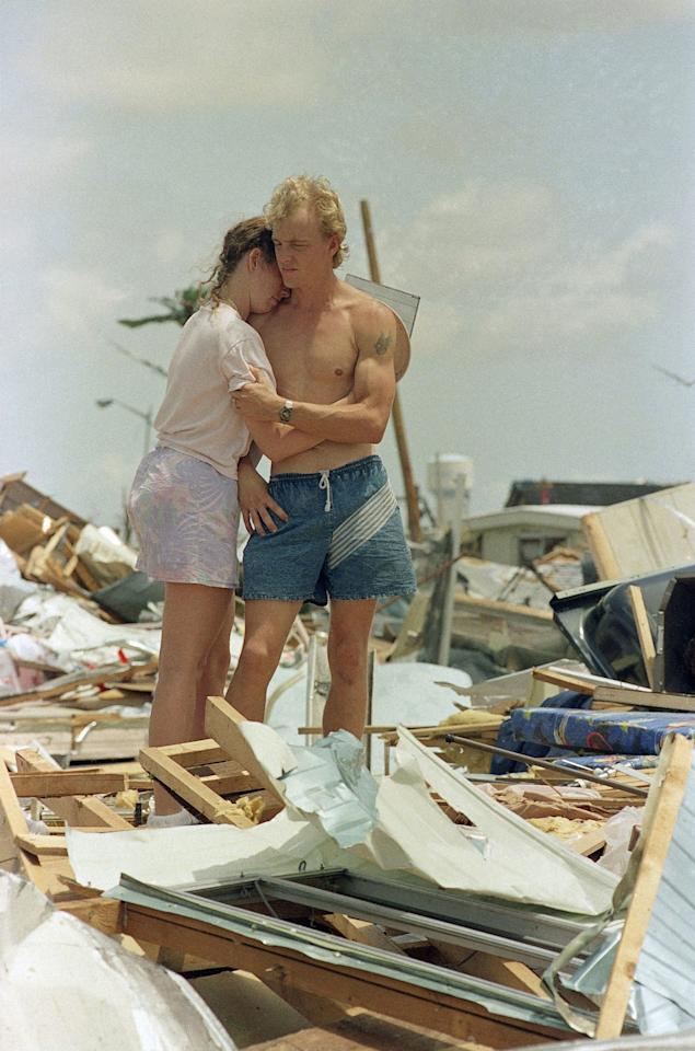 <p>Richard Cilinceon hugs his wife Mitzi at the site of their house trailer which they moved into in June, in Homestead, Fla., Aug. 25, 1992. Hurricane Andrew destroyed the couple's home and ruined most of their personal possessions. (AP Photo/Kathy Willens) </p>
