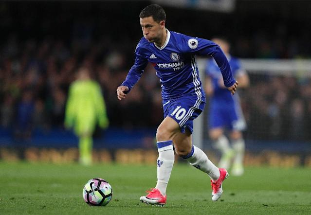 Chelsea midfielder Eden Hazard, who played like a ghost under Mourinho last season, will arrive at Old Trafford seeking to reach the milestone of 15 goals in a league campaign (AFP Photo/Adrian DENNIS)