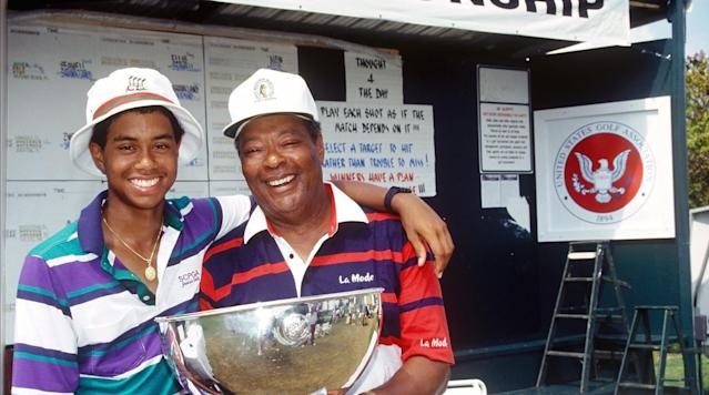 Tiger Woods and father Earl Woods pose for a photo while celebrating Tiger's victory at the 1991 USGA Junior Amateur Championships.