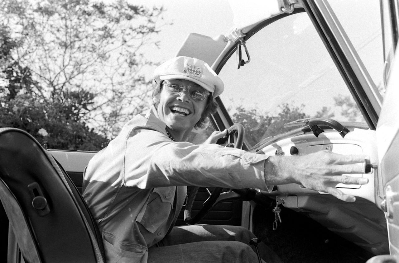 """Not published in LIFE. Jack Nicholson in his beloved Volkswagen convertible, Los Angeles, 1969. According to notes by writer Judy Fayard that accompanied Arthur Schatz's film when it was sent to LIFE's offices in New York, Nicholson said that """"anyone out here who doesn't drive a Volks is either ostentatious or stupid."""""""