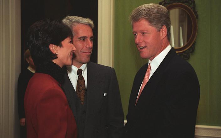 Ghislaine Maxwell in a red jacket speaks to Jeffrey Epstein and President Clinton
