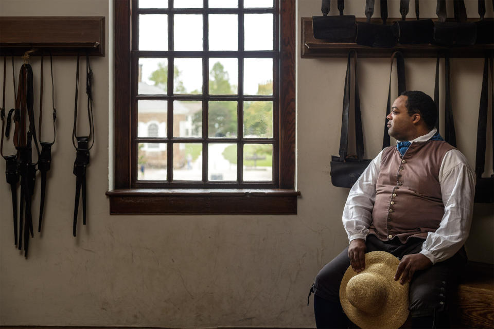 In this Sept 19, 2017 photo, Stephen Seals portrays James Armistead Lafayette at Colonial Williamsburg, an immersive living-history museum in Williamsburg, Virginia, where costumed interpreters of history reenact scenes and portray figures from that period. (Darnell Vennie/Colonial Williamsburg via AP)