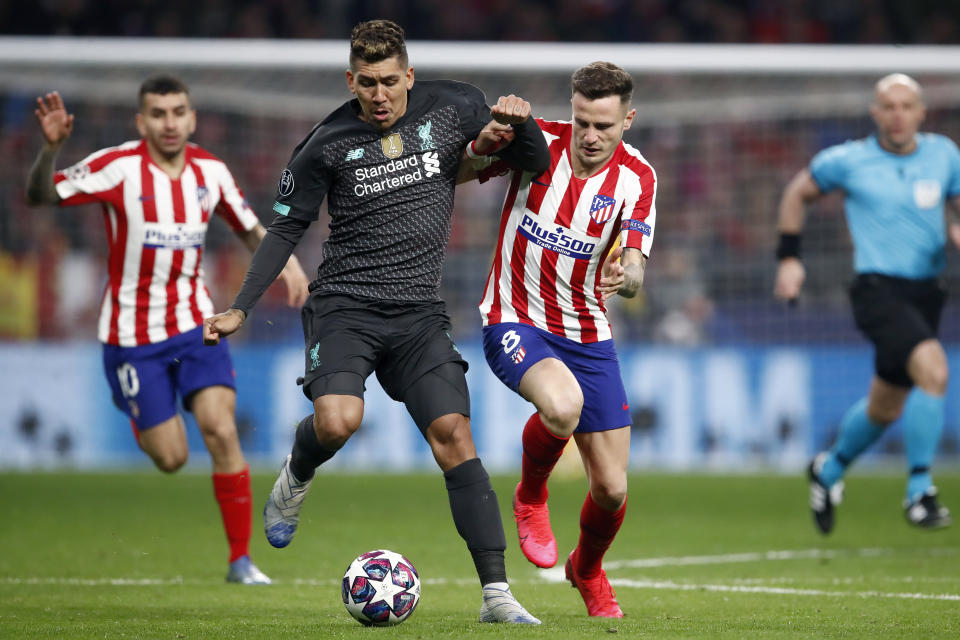 Saul Niguez (right) scored Atletico Madrid's only goal in a 1-0 win over Roberto Firmino and Liverpool. (Photo by Eric Verhoeven/Soccrates/Getty Images)
