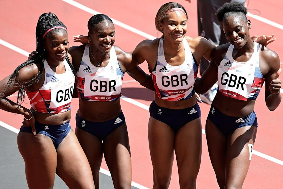 Britain's Asha Philip, Britain's Dina Asher-Smith, Britain's Imani Lansiquot and Britain's Daryll Neita pose after winning in the women's 4x100m relay heats during the Tokyo 2020 Olympic Games at the Olympic Stadium in Tokyo on August 5, 2021.  (AFP via Getty Images)