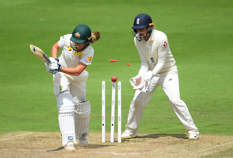 TAUNTON, ENGLAND - JULY 20: Sophie Molineux of Australia of Australia is bowled by Sophie Ecclestone (not pictured) of England watched on by Sarah Taylor of England during Day Three of the Kia Women's Test Match between England Women and Australia Women at The Cooper Associates County Ground on July 20, 2019 in Taunton, England. (Photo by Alex Davidson/Getty Images)