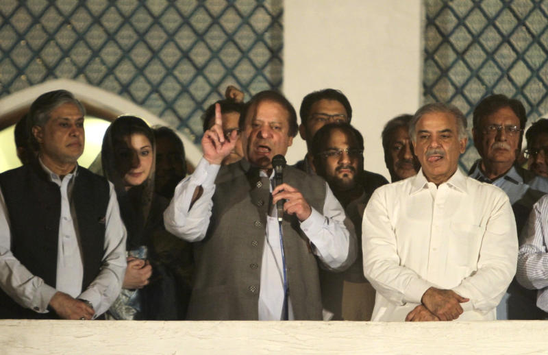 Former Prime Minister and leader of the Pakistan Muslim League-N party Nawaz Sharif, center, addresses his supporters as his brother Shahbaz Sharif, right, and daughter Maryam Nawaz, second from left, listen at a party office in Lahore, Pakistan, Saturday, May 11, 2013. Sharif  declared victory following an election marred by violence Saturday. Unofficial, partial vote counts show Sharif's party with an overwhelming lead. (AP Photo/K.M. Chaudary)