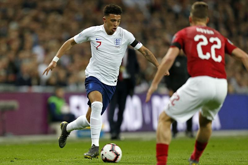 Jadon Sancho set up Raheem Sterling's opener on his first competitive start for England (AFP Photo/Ian KINGTON)
